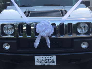 All Starz Limousine Service presents our Wedding Limousines fully dressed with flowers and ribbons of your choice and 2 complimentary chilled bottles of bubbly or wine (non-alcoholic) included with every booking.